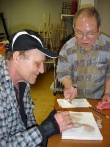 Tom explains drawing technique