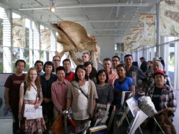 Facilitators Pose with Massive Whale at Beaty Museum